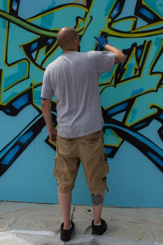 GRAFFITI ARTIST AT WORK – STREET FAIR IN PORTLAND, MAINE photo by Larry Cotton